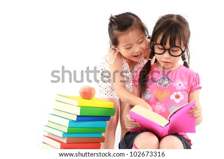 Two student little asian girl reading the book - stock photo