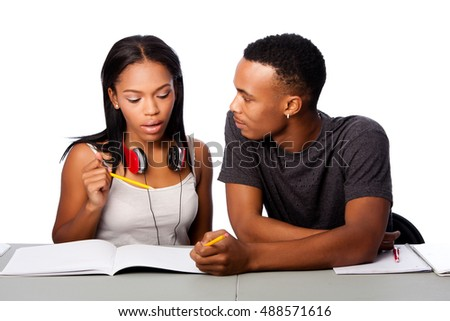 Two students happily studying together, on white.