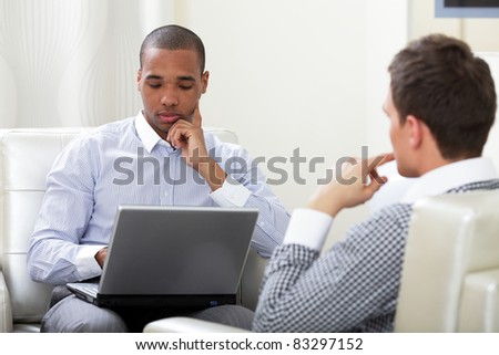 Two students having a discussion - stock photo