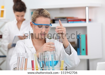 Two students in science class - stock photo