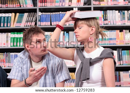 two students learning to exam in the library - stock photo