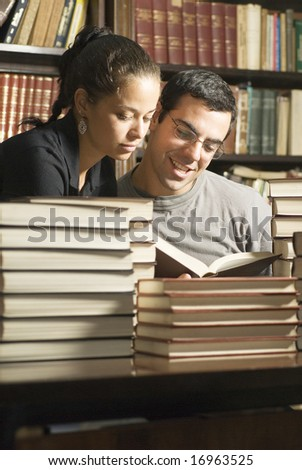 Two students looking at books - stock photo