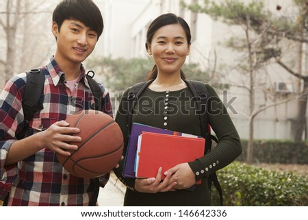 Two students portrait on college campus - stock photo