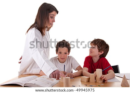 Two students with the teacher - stock photo