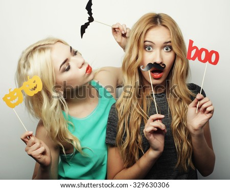 two stylish sexy hipster girls best friends ready for party, over gray background - stock photo