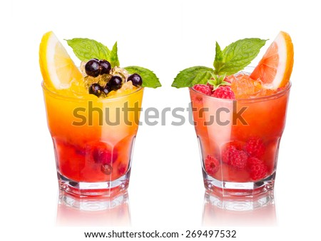 Two summer alcoholic fruity cocktails isolated on white - stock photo