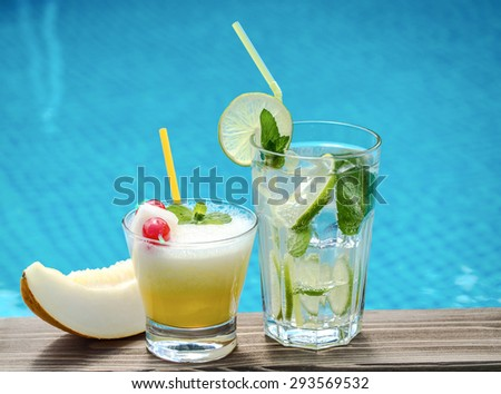 Two summer cocktails on a pool side - stock photo