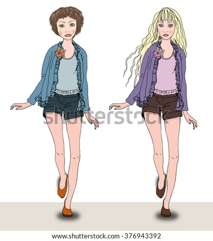Two summer fashion girls: blonde and  brunette. Wearing jacket and shorts. Standing at a wall. - stock photo