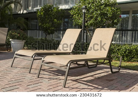 Two sun loungers by the pool. Florida, USA - stock photo