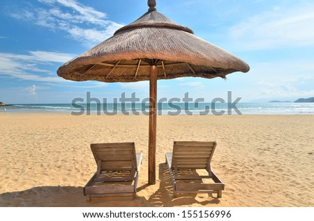 Two sunbeds on the tropical sandy beach -- Vacation and Tourism concept  - stock photo