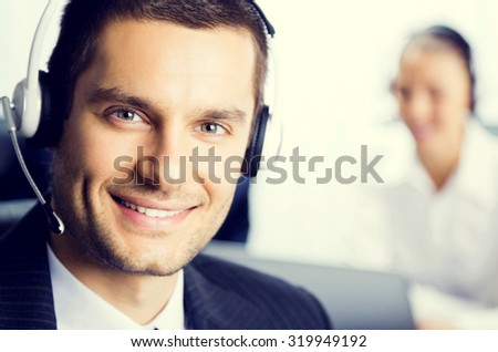 Two support phone operators at office, customer service concept - stock photo