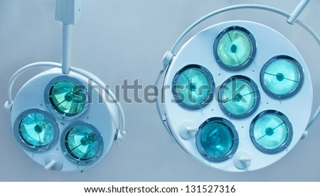 Two surgical lamps in operation room. - stock photo