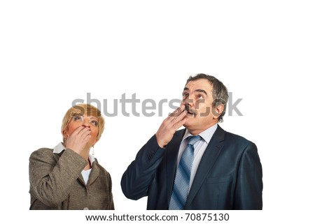 Two surprised mature business people looking up to copy space isolated on white background