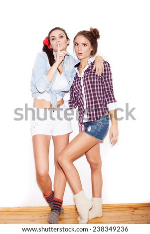 Two surprised young girl friends. Beautiful woman opening Mouth. Emotion. White background, not isolated - stock photo