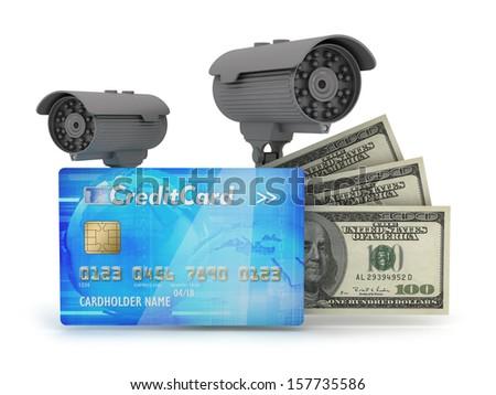 Two surveillance cameras, credit card and dollar bills - stock photo