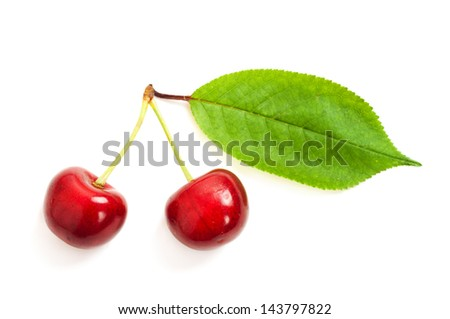 Two sweet cherry with leaf, isolated on white background, macro image