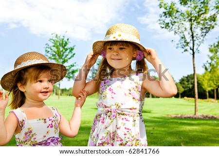 Two sweet kids in straw hats - stock photo