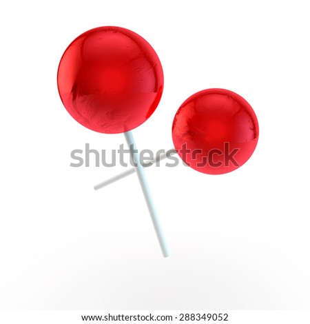 two sweet red round sugar candies on plastic sticks - stock photo