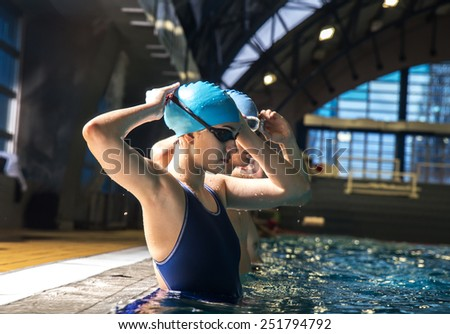 Two swimmers preparing to race at the swimming pool.Natural light ambient. - stock photo