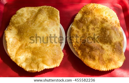 two tchebourek with meat on a table - stock photo