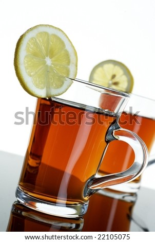 Two teas wit lemons - stock photo