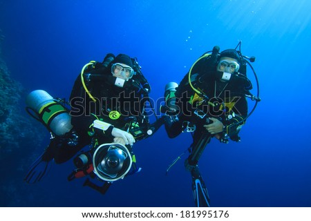 Two technical scuba divers using closed-circuit rebreathers - stock photo