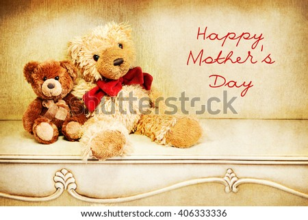 Two teddy bear on a vintage table. Happy Mother's Day