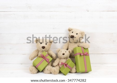 two teddy bear with presents