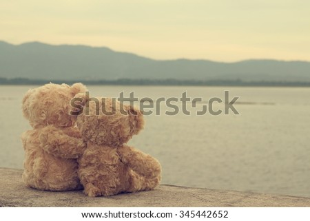 Two teddy bears hugging. vintage tone. - stock photo