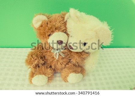 Two teddy. Concept about love and relationship, vintage photo.