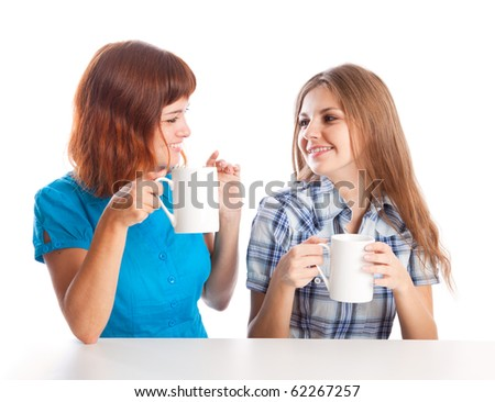 Two teen-girls are drinking tea. Isolated on white background