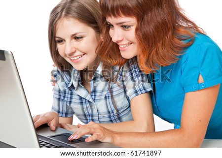 Two teen-girls with laptop. Isolated on white background