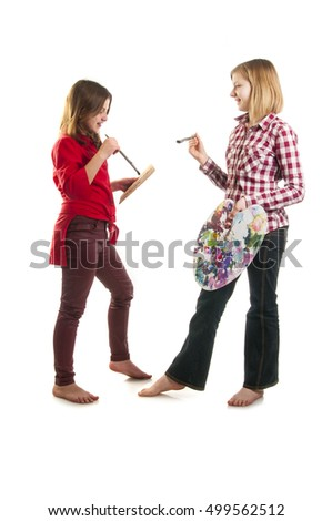 two teen girls with paint palette and brushes, isolated on white