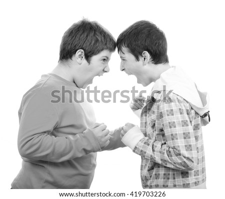 Two teenage boys screaming, yelling and fighting isolated on white background. - stock photo