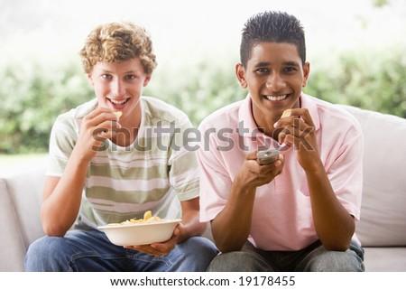 Two Teenage Boys Watching TV - stock photo