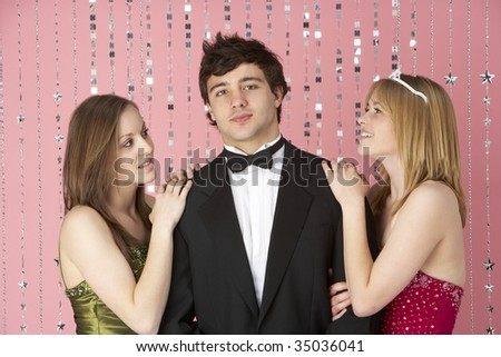 Two Teenage Girls Looking At Boy - stock photo