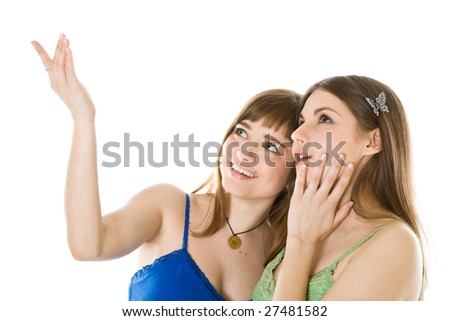 Two teenage girls looking up. Isolated on white background - stock photo