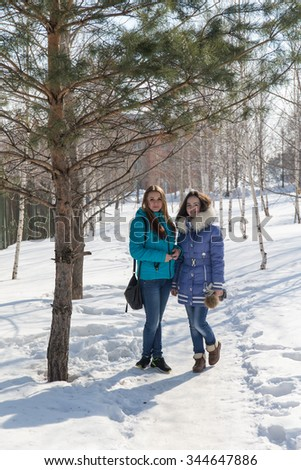 Two teenage girls outdoors in winter day