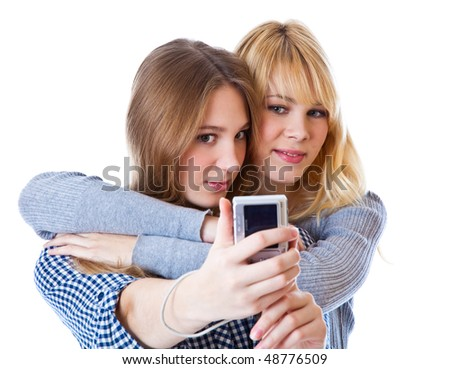 Two teenage girls photographing on camera. Isolated on white background - stock photo