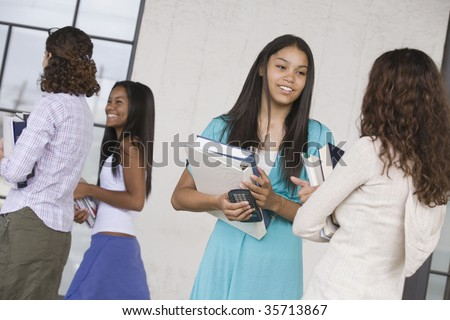Two teenage girls talking to each other - stock photo
