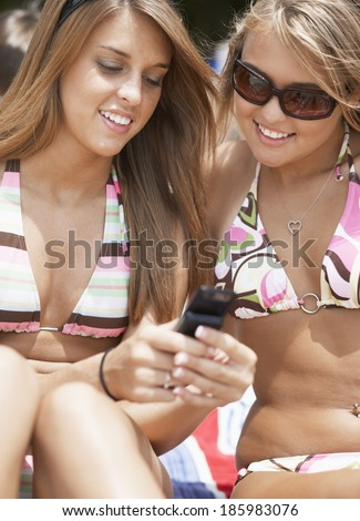 Two Teenage Girls Text Messaging