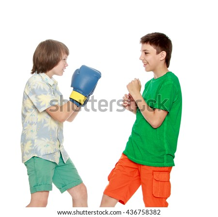 Two teenager boy Boxing each other-Isolated on white background - stock photo