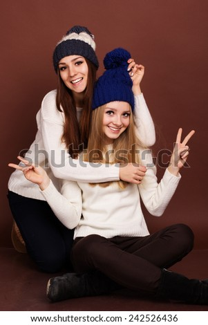 Two teenager girls friends in winter clothes  - stock photo