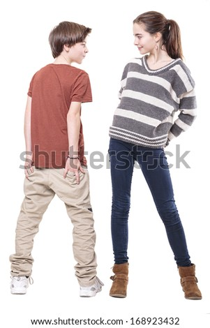 two teenager, male and female smiling at each other, isolated on white. - stock photo