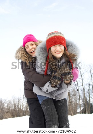 Two teenagers best friends having fun together during winter season