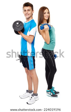 Two teenagers boy and girl doing fitness workout with weights isolated on white background - stock photo