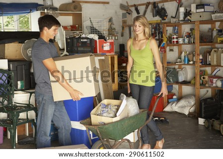 Two Teenagers Clearing Garage For Yard Sale - stock photo