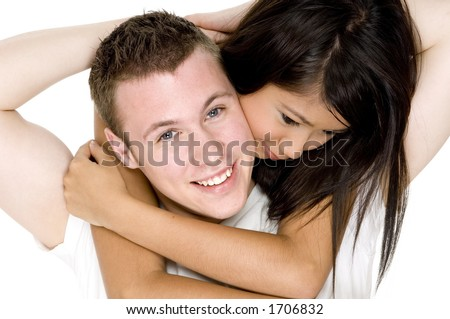Two teenagers in love wearing white on white background