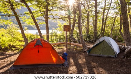 Two tents in a c&site near a lagoon / C&ing gear / C&ing next to a & Two Tents Campsite Near Lagoon Camping Stock Photo 602719328 ...