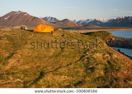 two tents in the shine of the midnight sun in iceland
